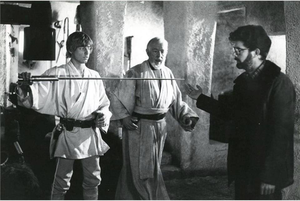 george lucas with Luke and Obi Wan Kenobi in a footage of a scene from The New Hope