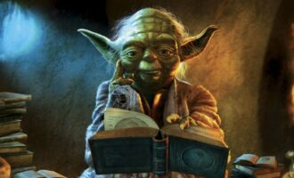 Yoda thinking over a pile of books