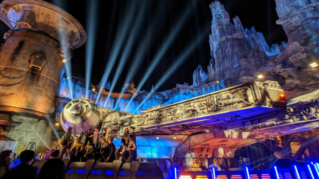Millenium Falcon at night with light pointing the sky